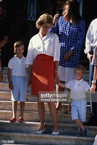 Princess Diana with her sons Prince William and Prince Harry at a photocall on the steps of the Marivent Palace during their summer holiday in...