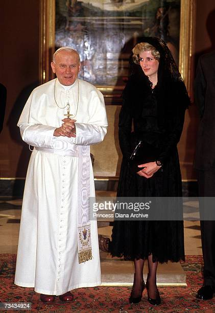 Princess Diana with Pope John Paul II at the Vatican in Rome April 1985 The princess is wearing a calflength black lace dress by Catherine Walker and...