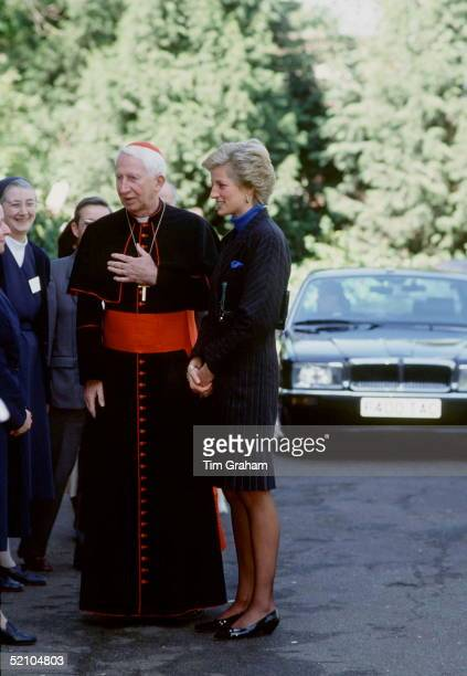 Princess Diana With Roman Catholic Cardinal Basil Hume Chatting To Nuns At A Shelter For Homeless People In West London