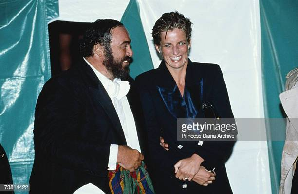 Princess Diana with wet hair talking to Italian tenor Luciano Pavarotti at a concert in Hyde Park London 30th July 1991