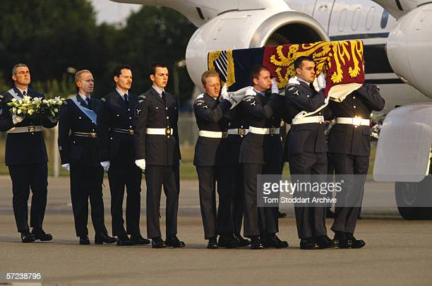 Princess Diana's body is carried by airmen after it was brought back from Paris to RAF Northolt after the car crash which killed her