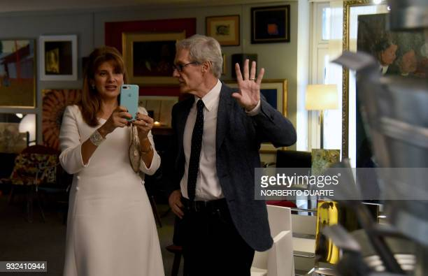Princess Dina Mired of Jordan Presidentelect of the International Union Against Cancer takes a picture with her cellphone next to the honorary consul...