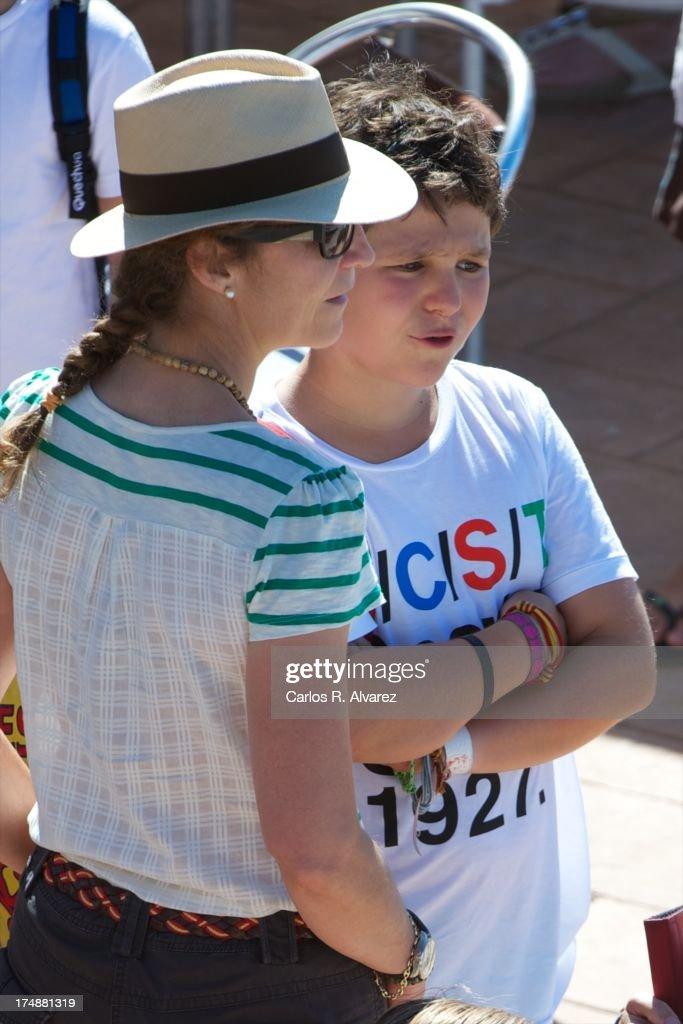 Princess Elena of Spain and her son Felipe Juan Froilan Marichalar arrive at Calanova Sailing School on July 29, 2013 in Palma de Mallorca, Spain.