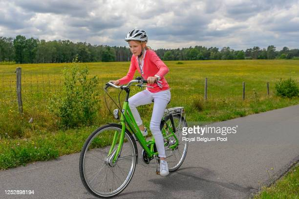 Princess Eleonore of Belgium rides a bike during a visit with King Philippe of Belgium, Queen Mathilde of Belgium, Princess Elisabeth of Belgium,...