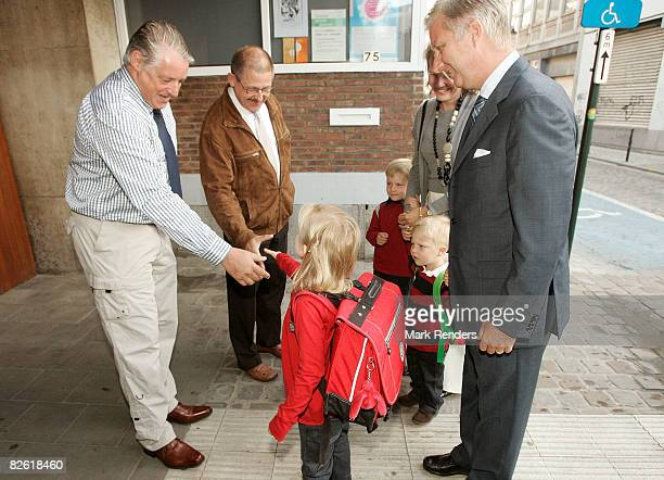 Princess Elisabeth of Belgium greets her new Principal on first day of school in presence of Prince Philippe Prince Emmanuel Princess Mathilde and...