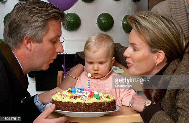 Princess Elisabeth of Belgium is presented with a cake by her parents Princess Mathilde and Prince Philippe of Belgium on October 25 2002 in Brussels...
