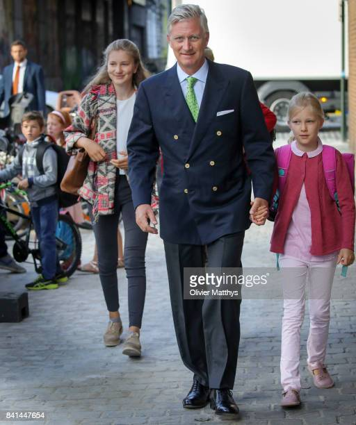 Princess Elisabeth of Belgium King Philippe of Belgium and Princess Eleonore of Belgium arrive at the St John Bergmans college to attend the first...