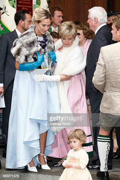 Princess Elisabeth von Thurn und Taxis and her mother Princess Gloria von Thurn und Taxis attend the wedding ceremony of Princess Maria Theresia von...