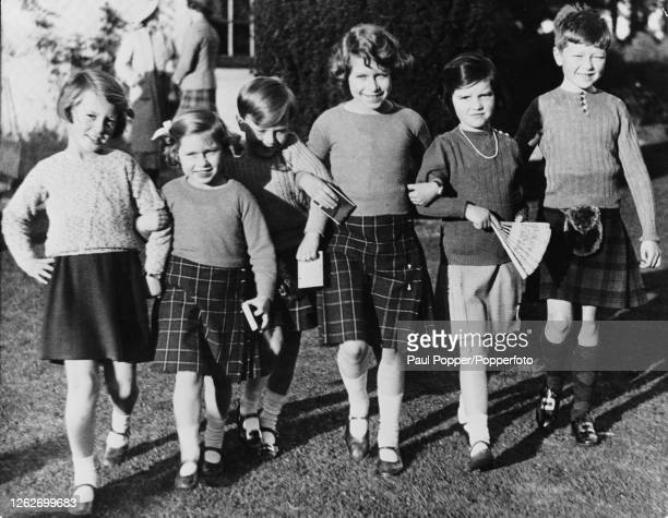 Princess Elizabeth , 4th from left, and Princess Margaret, 2nd from left, join other young guests to celebrate the 6th birthday of Master James...