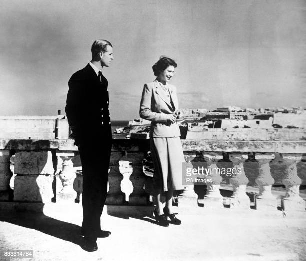 Princess Elizabeth, accompanied by the Duke of Edinburgh, looks over Valetta from the roof of the Villa Guardamangia, Malta. Duke of Edinburgh was...