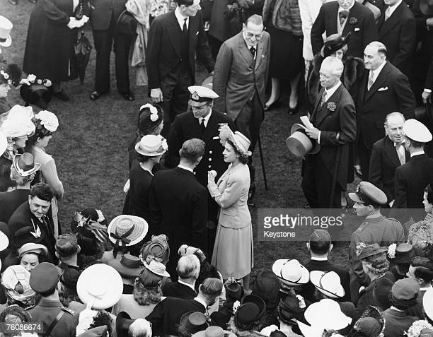 Princess Elizabeth and her fiance, Philip Mountbatten , at a Buckingham Palace garden party, 10th July 1947.