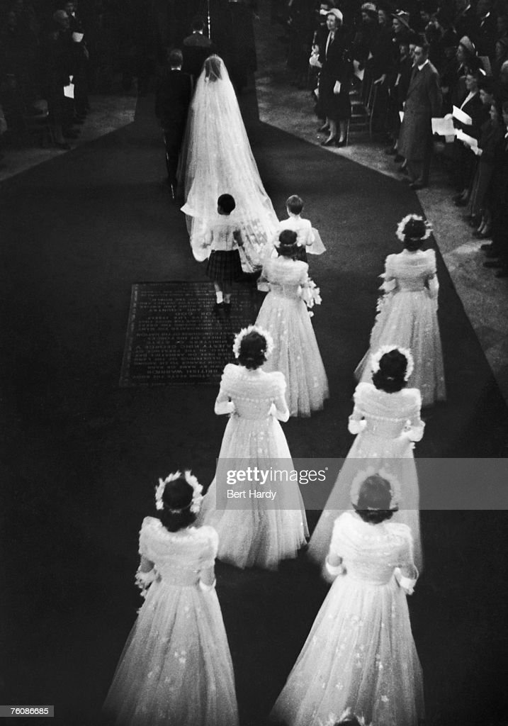 Princess Elizabeth (later Queen Elizabeth II) and her fiance Philip Mountbatten enter Westminster Abbey before their wedding, 20th November 1947. Original publication: Picture Post - 4438 - Royal Wedding - pub. 29th November 1947