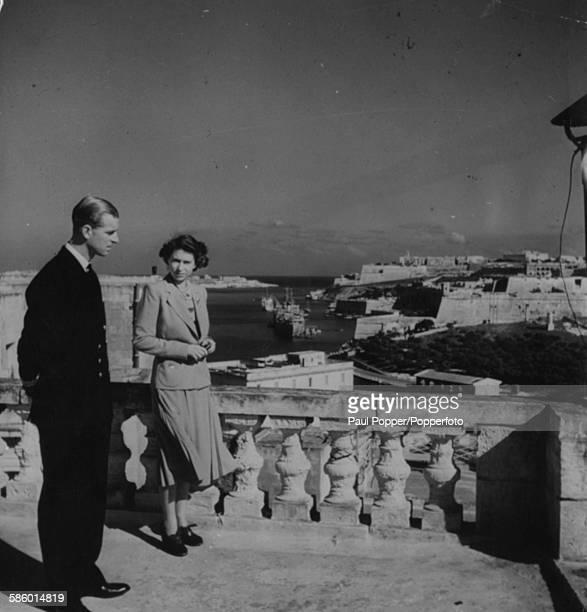 Princess Elizabeth and her husband Prince Philip Duke of Edinburgh pictured standing together on a roof promenade above Villa Guardamangia...