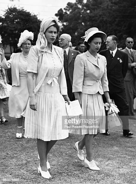 Princess Elizabeth and her sister Princess Margaret, followed by their mother Queen Elizabeth, pictured walking at Kenilworth Racecourse in Cape Town...