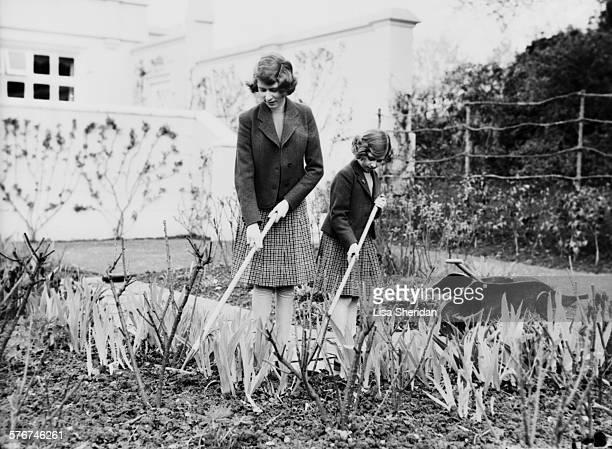 Princess Elizabeth and her sister Princess Margaret gardening at the Royal Lodge, Windsor, April 1940.