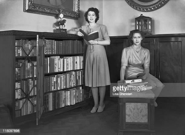 Princess Elizabeth and her sister Princess Margaret in a library in Buckingham Palace on July 19, 1946.