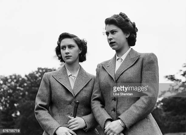 Princess Elizabeth and her sister Princess Margaret wearing riding habits at the Royal Lodge, Windsor, UK, 8th July 1946.