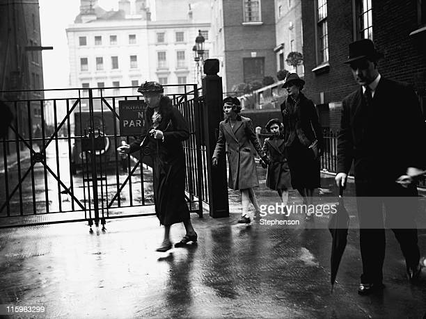 Princess Elizabeth and her sister Princess Margaret with their nanny Marion Crawford leaving the headquarters of the YWCA off Tottenham Court Road...