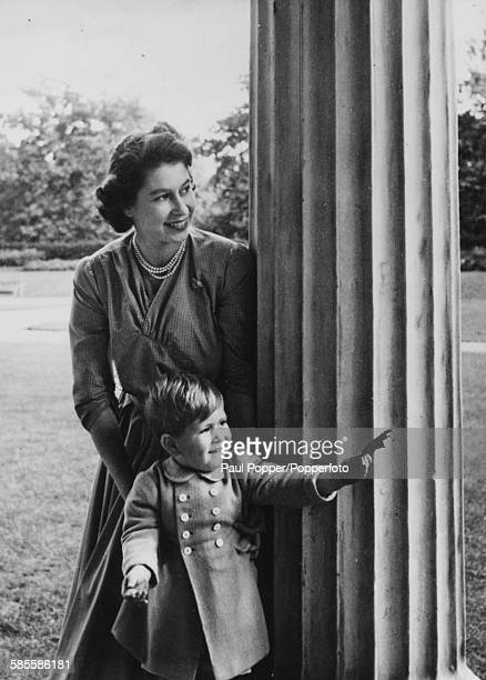 Princess Elizabeth and her son Prince Charles hiding behind a pillar as they play hide and seek on the eve of Princess Anne's christening London 20th...