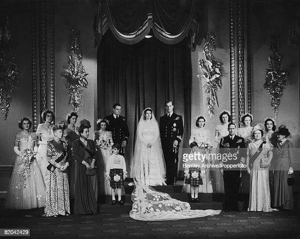 Princess Elizabeth and Philip Duke of Edinburgh pose with King George VI and Queen Elizabeth and other members of the royal family at Buckingham...
