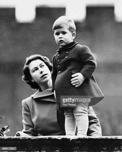 Princess Elizabeth and Prince Charles watching a procession during the visit of Queen Juliana of the Netherlands from the wall of Clarence House...