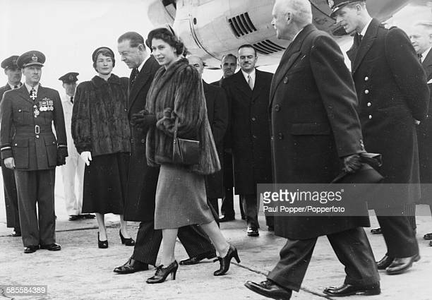 Princess Elizabeth and Prince Philip are accompanied by Harold Alexander, Governor General of Canada, arriving at Dorval Airport in Montreal, October...
