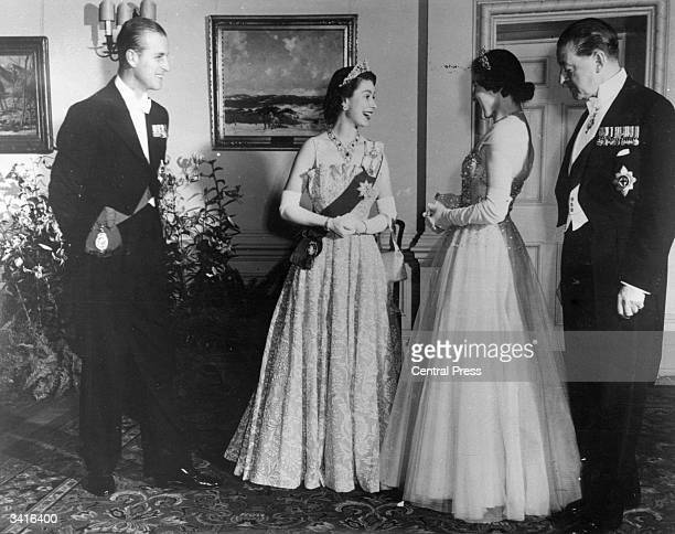 Princess Elizabeth and Prince Philip Duke of Edinburgh with Lord and Lady Alexander at a state banquet in Ottawa during the Royal Tour of Canada 12th...