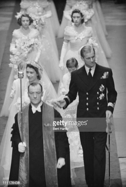 Princess Elizabeth and Prince Philip make their way down the aisle of Westminster Abbey London on their wedding day 20th November 1947 Original...