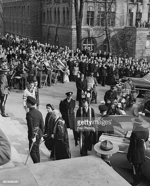 Princess Elizabeth and Prince Philip the Duke of Edinburgh are greeted by crowds as they arrive for a visit at McGill University Montreal November...