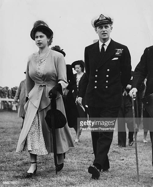 Princess Elizabeth and Prince Philip, the Duke of Edinburgh, walk the course at Epsom Races, England, June 5th 1948.