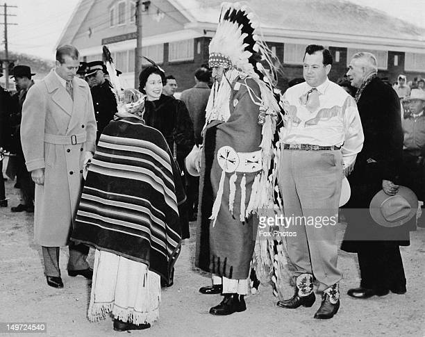 Princess Elizabeth and Prince Philip with First Nations residents of the Indian Village Calgary and the mayor of Calgary Donald Hugh Mackay 24th...