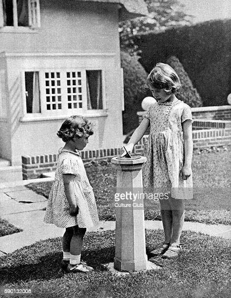 Princess Elizabeth and Princess Margaret as children in the 'grounds' of the model house - Y Bwthyn Bach - presented to them on Elizabeth's 6th...