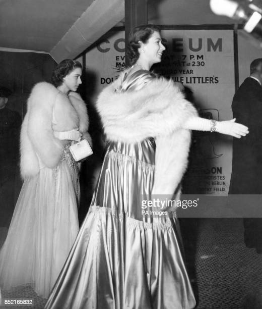 Princess Elizabeth and Princess Margaret as they arrived at the Coliseum London tonight to attend the Royal Command Variety Performance with the King...