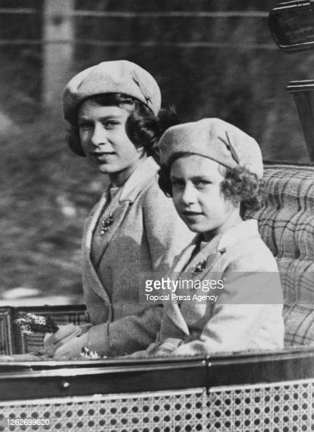 Princess Elizabeth and Princess Margaret ride in a carriage with the King and Queen to Crathie Kirk from Balmoral Castle to attend a morning service,...