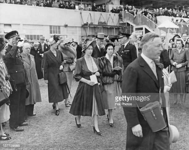 Princess Elizabeth and Princess Margaret walking through the paddock at the Derby Epsom Downs Racecourse Surrey 27th May 1950