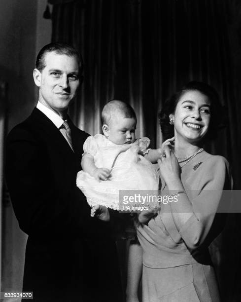 Princess Elizabeth and the Duke of Edinburgh hold their first child Prince Charles aged 6 months