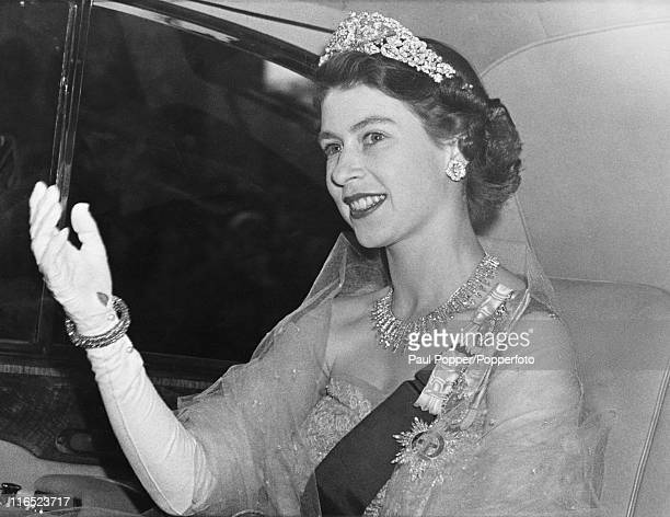 Princess Elizabeth arrives at the Norwegian Embassy in London for a dinner party hosted by King Haakon VII of Norway, 6th June 1951. The King is in...