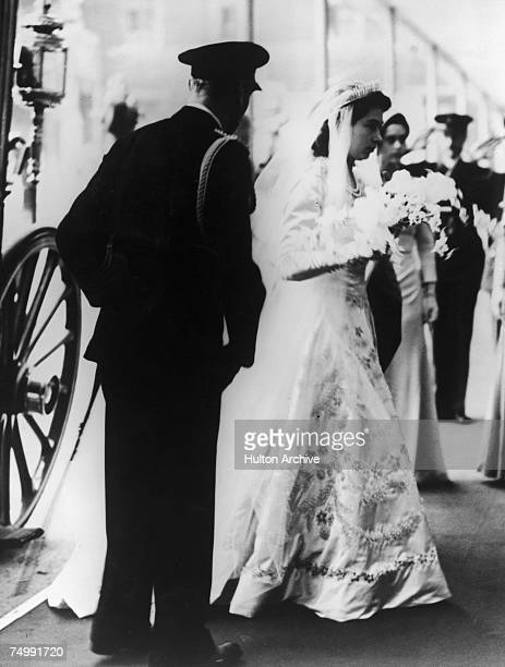 Princess Elizabeth arrives at Westminster Abbey London with her father King George VI for her marriage to Lt Philip Mountbatten 20th November 1947