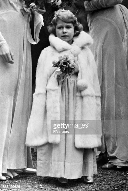 Princess Elizabeth arriving at the 16th century church at Balcombe Sussex for the wedding of Lady May Cambridge and Captain Henry Abel Smith
