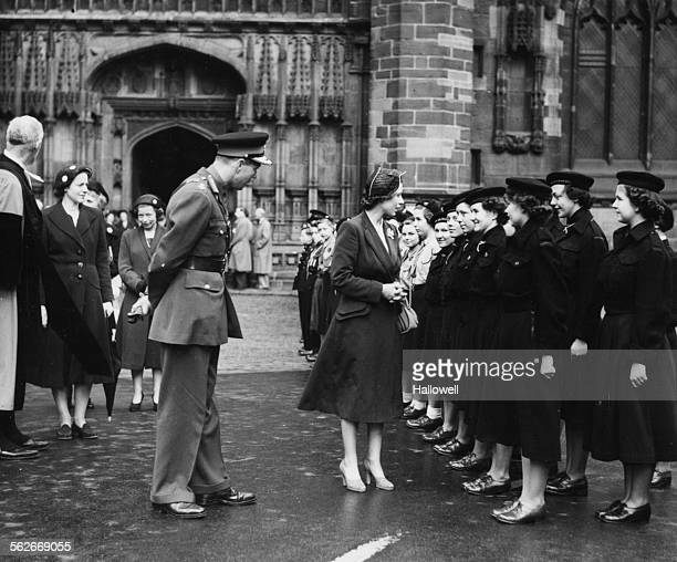 Princess Elizabeth chatting to a group of Sea Rangers as she inspects a Guard of Honor with Lord Leverhulme Lord Lieutenant of the County leaving...