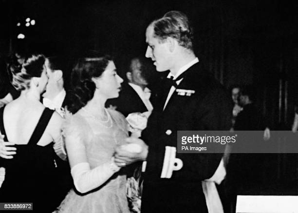 Princess Elizabeth dancing with her fiance, Lieutenant Philip Mountbatten, RN, at the Assembly Rooms, Edinburgh, when a ball was held to welcome the...