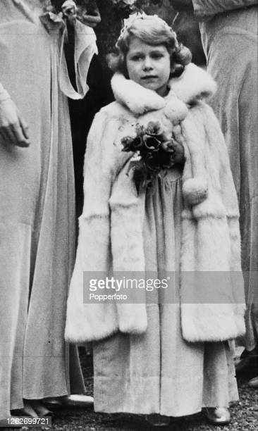 Princess Elizabeth , dressed as a bridesmaid, attends the wedding of Lady May Cambridge and Captain Henry Abel Smith at the village church of St Mary...