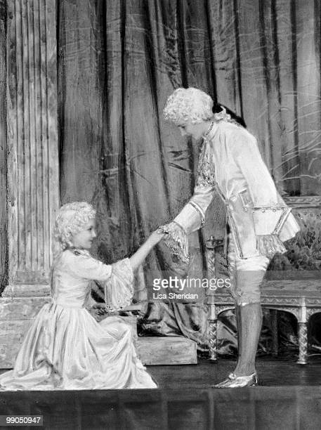 Princess Elizabeth dressed as Prince Charming with Princess Margaret as Cinderella during a royal pantomime at Windsor Castle Berkshire Great Britain...