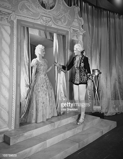 Princess Elizabeth dressed in an elaborate gown during a royal pantomime production of 'Old Mother Red Riding Boots' at Windsor Castle Berkshire...