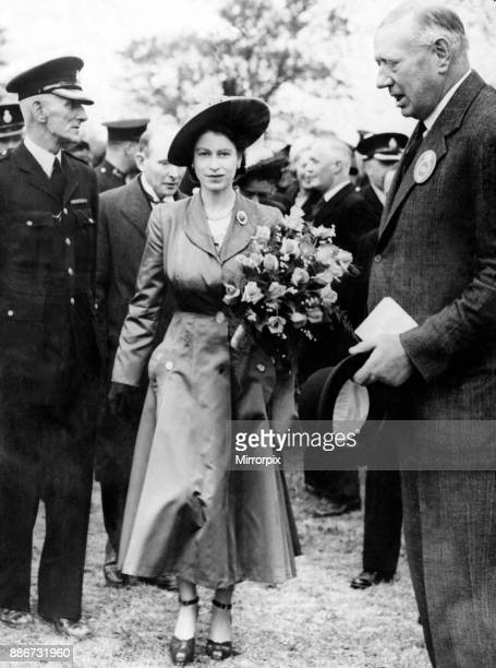 Princess Elizabeth during a visit to Wales, pictured at the main show ring, greeted by Col H C C Batten . May 1948.