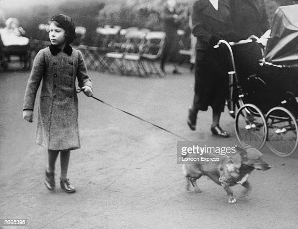 Princess Elizabeth exercising one of her Corgi dogs in London's Hyde Park