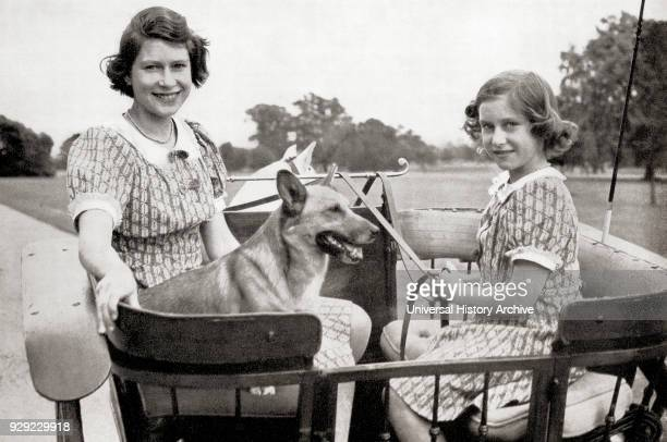 Princess Elizabeth, future Queen Elizabeth II, left, and Princess Margaret, right, driving a pony and trap in Great Windsor Park, England, 1941....