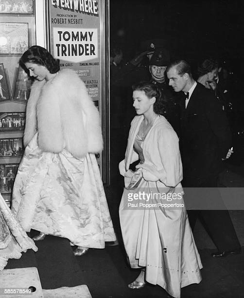 Princess Elizabeth her sister Princess Margaret and her husband to be Lieutenant Philip Mountbatten arrive for the Royal Command Variety Performance...