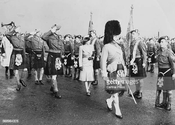 Princess Elizabeth inspecting the Colors at the ceremony of the Presentation of the Freedom of the Burgh of Stirling Stirling Castle Scotland...