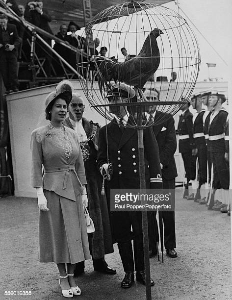 Princess Elizabeth inspects a Naval Guard of Honour and the golden cockerel mascot during a visit to Coventry to open the redeveloped Broadgate...